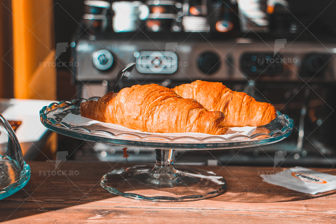 Coffee shop, fresh baked croissants on glass plate