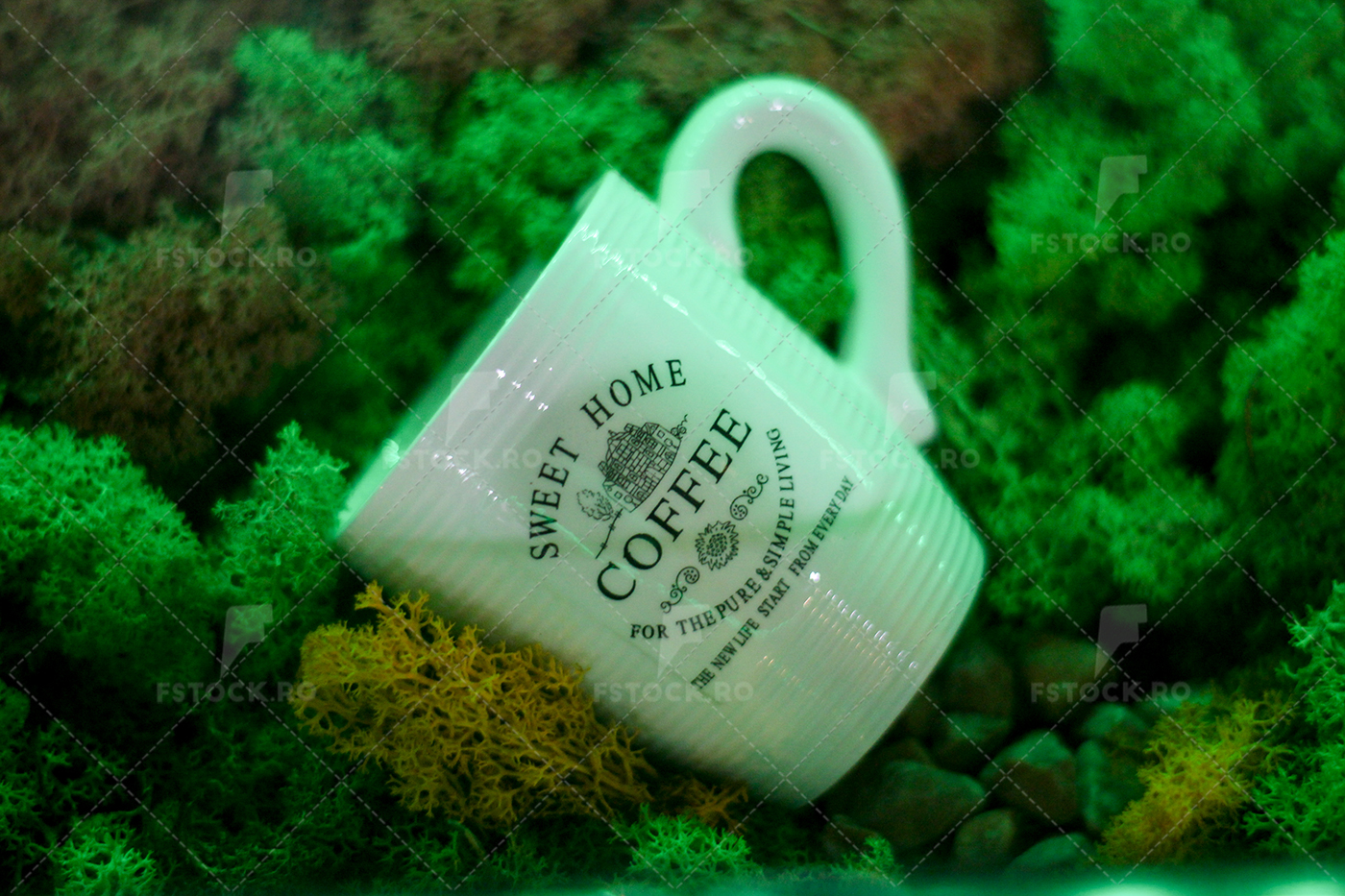 Cup of coffee exposed with conserved grass